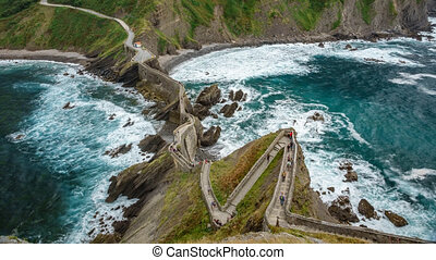 Top view Time Lapse of San Juan de Gaztelugatxe islet with zigzag steps in Bermeo, Spain. Mythical scenery of Dragonstone
