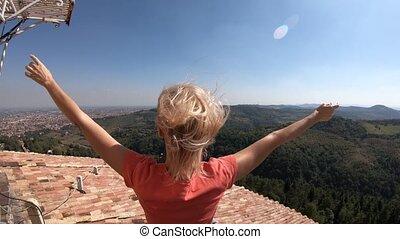 San Luca Bologna viewpoint - woman enjoys the top panorama ...
