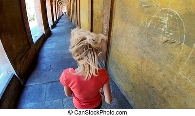 San Luca Sanctuary stairway - SLOW MOTION: woman in...