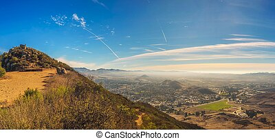 Aerial view of San Luis Obispo in California from the hiking trail to Cerro Peak. Cerro is part of the chain of peaks called the Nine Sisters and is popular for hiking, jogging and mountain biking.