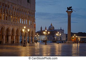 San Marco square with lion on column and San Giorgio Maggiore basilica, dawn in Venice, Italy