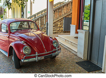 Old car in the city center of San Marino