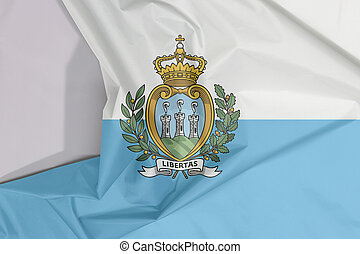 San marino fabric flag crepe and crease with white space, a horizontal bicolour of white and light blue; charged with the Coat of arms.