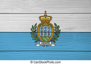 San marino flag color painted on Fiber cement sheet wall background, a horizontal bicolour of white and light blue; charged with the Coat of arms.
