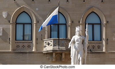 San Marino - Statue and flag in San Marino