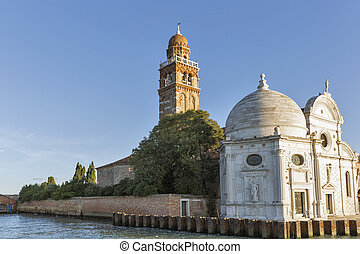 San Michele cemetery church in Venice at sunset, Italy.