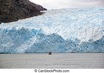San Rafael Glacier, Patagonia, Chile - Boat in front of the...