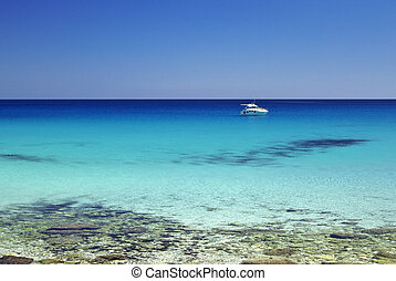 San Vito quater - Motorboat anchored not too far from San...