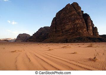 Wadi Rum - sand and mount Seven Pillars in Wadi Rum, Jordan