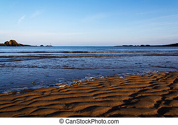 Sand and sea on the seafront at Bude, Cornwall