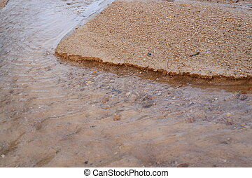 Sand and water flow