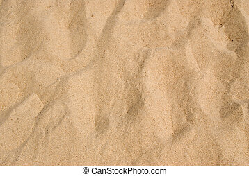 A textured background of white sand