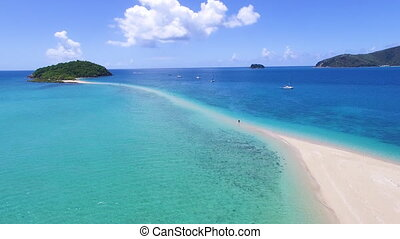 Sand bar and ocean with mountains - An aerial shot of a sand...