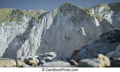 Sand beach among rocks at Atlantic Ocean coast in Portugal