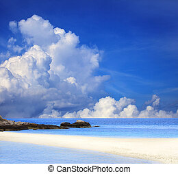 sand beach and blue sky in cloudy day