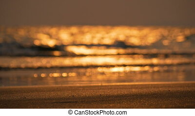 Sand beach and blurred with bokeh background of sea wave