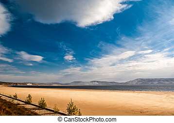 Sand beach and clouds in the sky