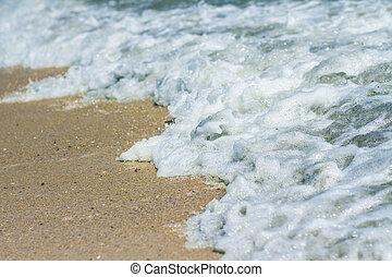 Sand beach and sea foam