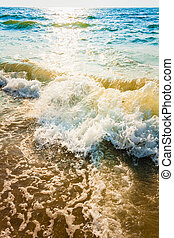 Sand beach and wave - Soft sea ocean waves wash over sand...
