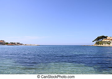 Blue sandy beach and sea in Renecros at Bandol village, France