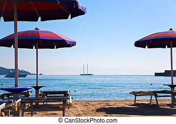 sand beach in Giardini Naxos (seaside town in Sicily) and...