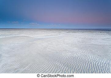 sand beach on North sea at sunrise