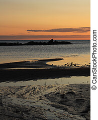 Sand beach shaped by the water at sunrise. Summer scene in ...