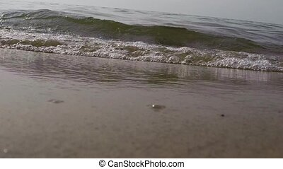 Sand beach water and waves backgrou - Waves on a sand beach...