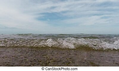 Sand beach water waves lake front - Waves on a sand beach...