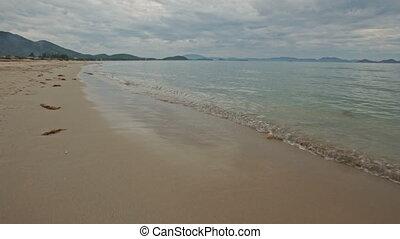 Sand Beach Wave Surf of Transparent Shallow Azure Sea
