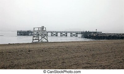 Sand beach with pier - Sand beach with wooden fishing pier