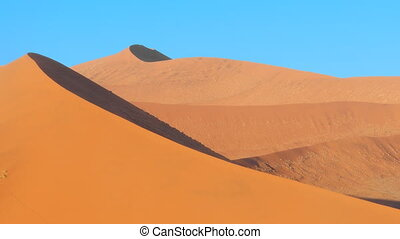 sand blowing on a dune - wind blowing on a dune at...