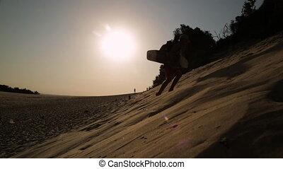 Sand boarding At Sunset, Qld Island