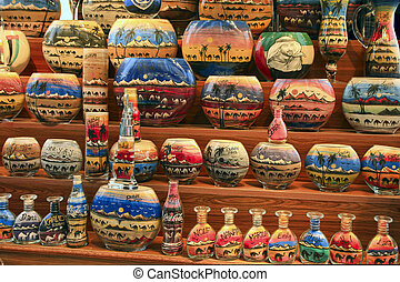 Sand bottle souvenirs at the Madinat Jumeirah Souk, Dubai, UAE. Handmade, full.  Decorative glass bottles with colored sand inside making shapes of desert and camels