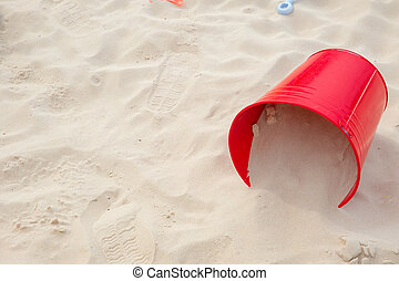Sand bucket at the seabeach with space for text summer fun at sea concept