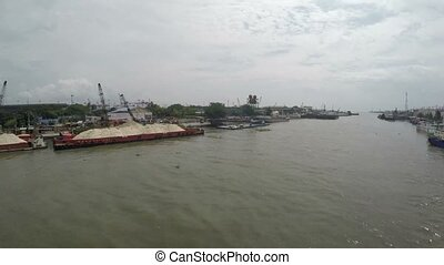 Sand Cargo ships docked on huge Pasig river to unload
