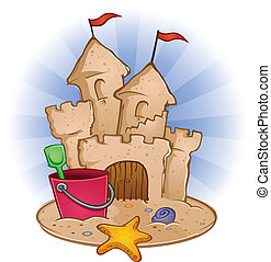 A sandcastle on the beach with a starfish and a bucket and pail