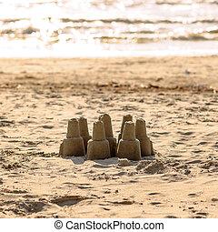 Sand castle - leisure activity at the beach