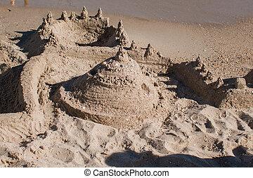 sand castle on the beach near the sea