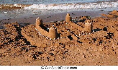 Sand castle. Two angles. - Sand castle at the beach. Prince...