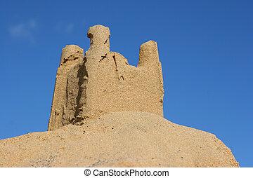 sand castle with blue sky