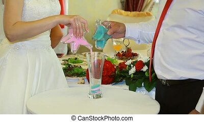 sand ceremony being performed at wedding