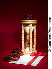 Sand clock with with white envelope