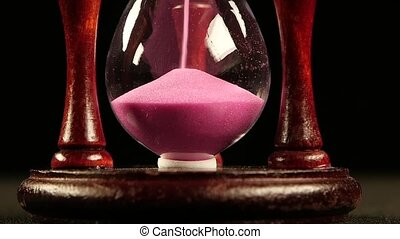 Sand completely in the bottom of the hourglass. Black. Slow...