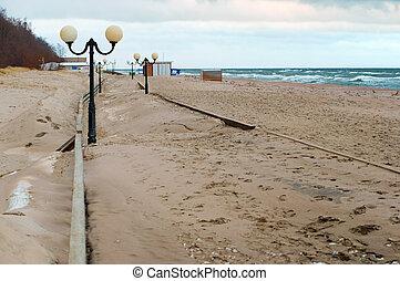 sand-covered promenade, sea promenade after storm