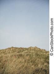 Sand Dune Against a Blue Sky
