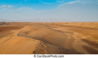 Sand dunes at Dasht-e-Lut, a large salt desert located in...