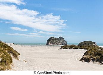 sand dunes at Wharariki beach, New Zealand
