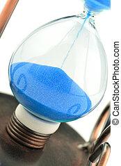 Sand-glass on dollars blue tone