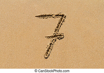 Sand Number - The number 7 drawn on sand at the beach,...